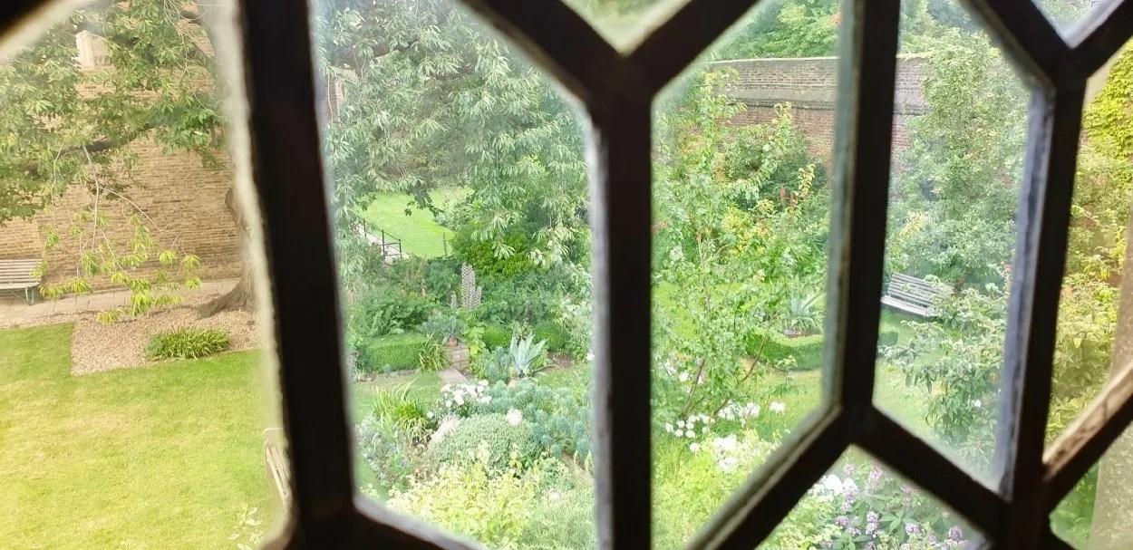 Charterhouse London garden seen through Tudor window panes