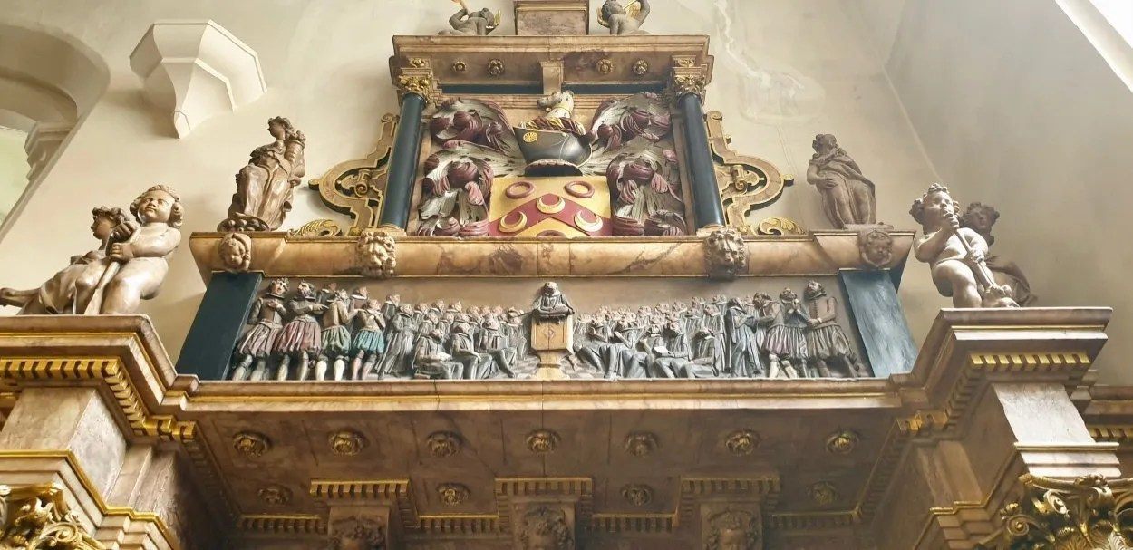 Thomas Sutton tomb Charterhouse London painted carved scene showing Tudor men