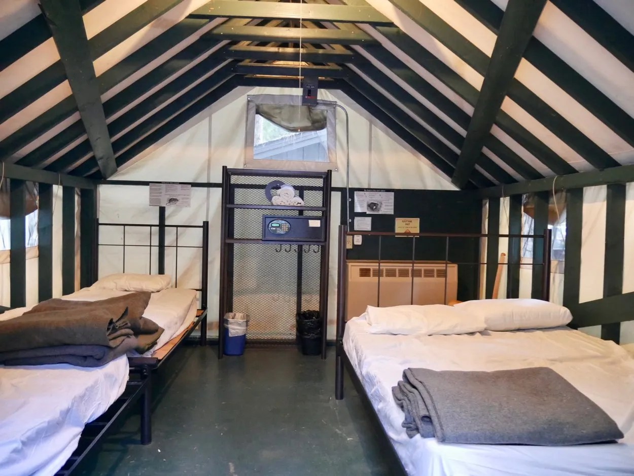 One double bed, two single beds interior family tent cabin Curry Village Yosemite