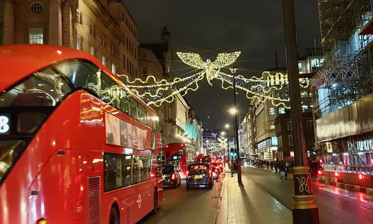 Red London Bus with Anteros Christmas lights Piccadilly