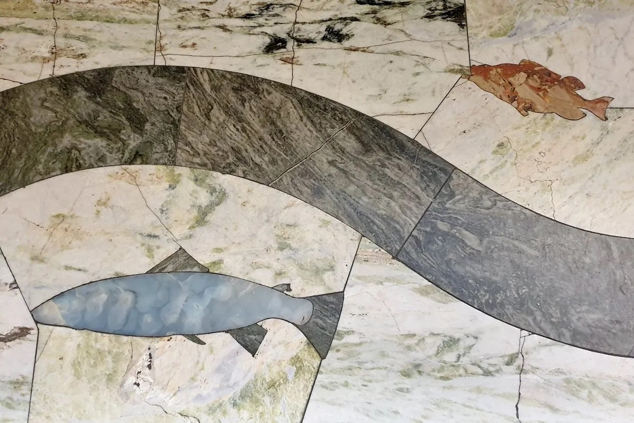 Marble inlay of fish on floor of St Andrews Chapel Westminster Cathedral London