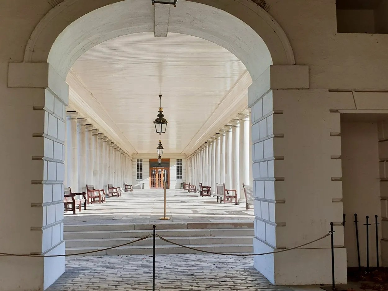Stone archway looking onto a colonnade at Queen's House Greenwich