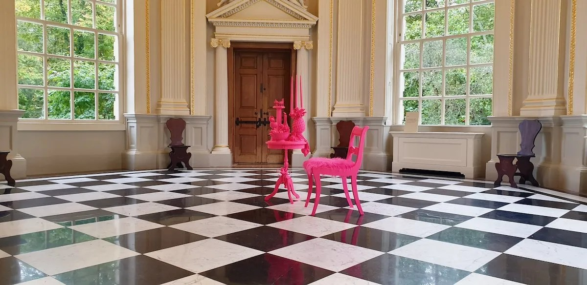 Pink table and chair on black and white baroque tiles Alice in Hackneyland X Orleans House Gallery