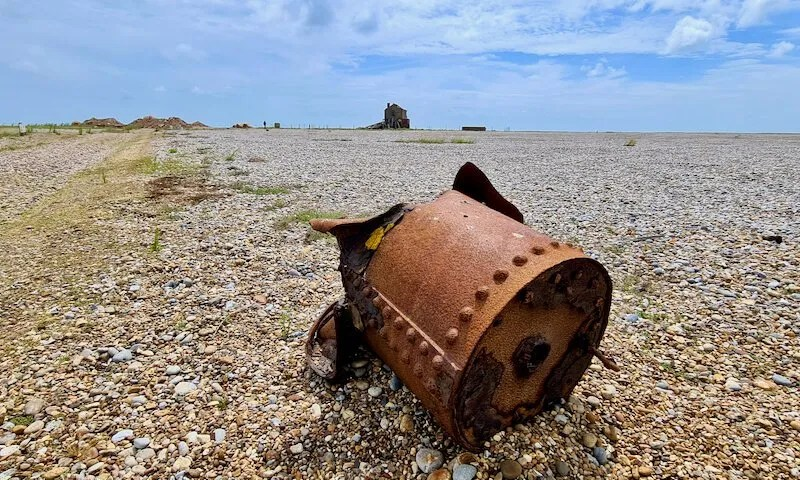 Rusted metal drum with the Black Beacon on the horizon