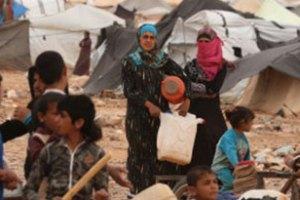 Refugiados Sírios na fronteira com a Jordânia.
