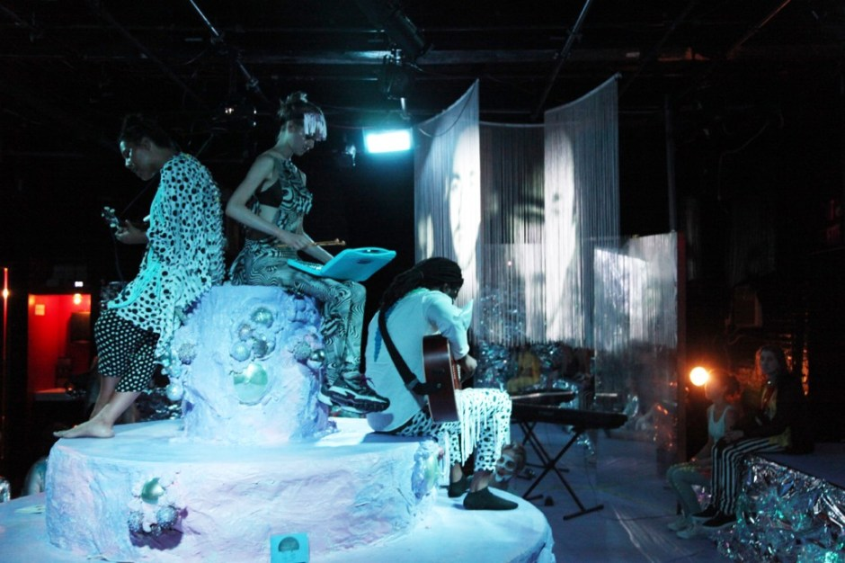 Photo by Jordan Harrison. Performers (L to R):  Luica Roderique, Caitlin Goldie, Seon Gomez, Ryan Pater (in projection), Scears Lee (on floor)