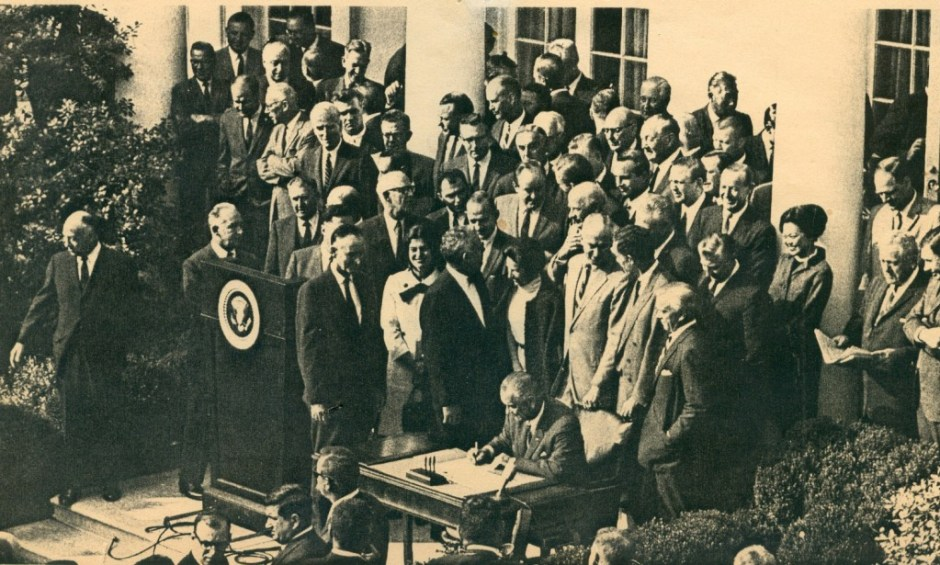 President Lyndon Johnson signs the legislation creating NEH and NEA.