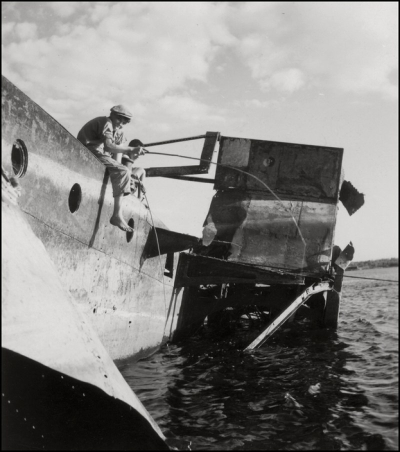 UKRAINE. 1943. Black Sea. Boys fishing on Wreckage. M-UK-SWM-005