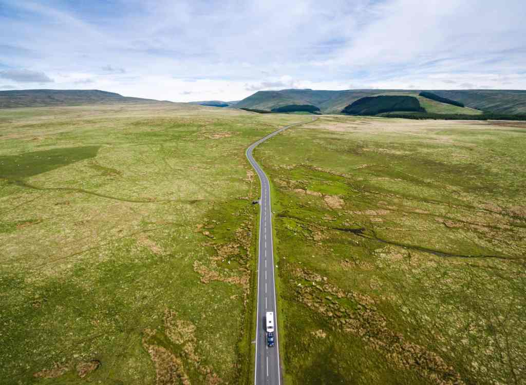 drone shot of person solo caravanning