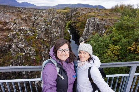 Michelle and Masha standing between the tectonic divide of the European and North American continents at Alþingi