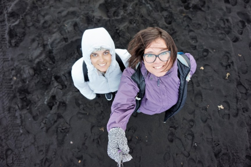 Michelle and Masha standing on the black-sand beaches of Vik