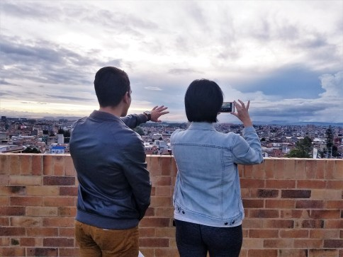 Michelle's cousin, Andres, giving Masha the lay of the land from his rooftop in Bogota, Colombia