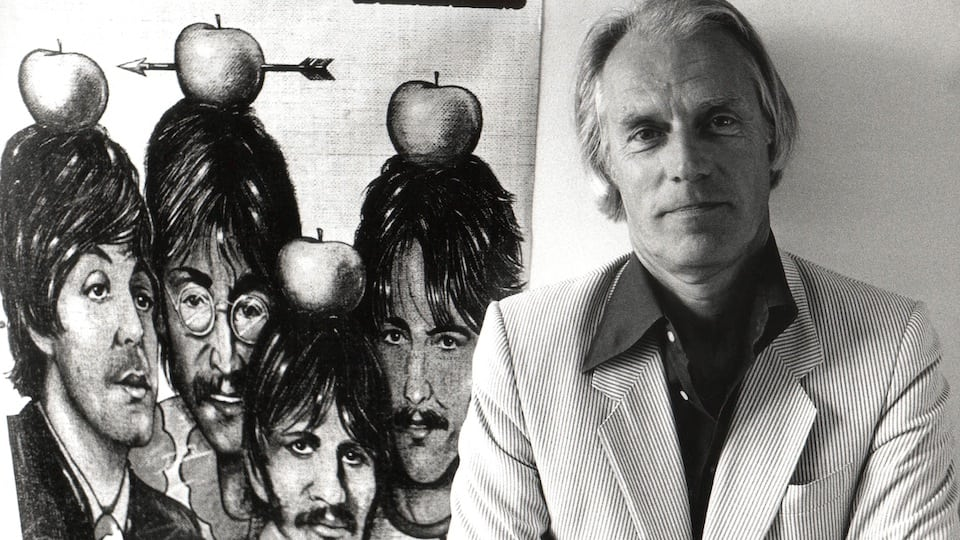 George Martin with Beatles poster (Getty Images)