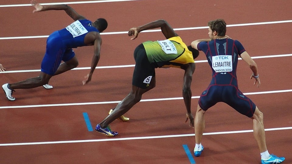 Usain Bolt with other runners