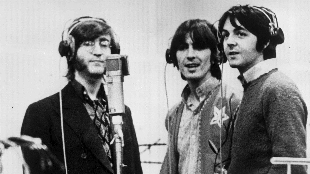 Three Beatles With Headphones Getty