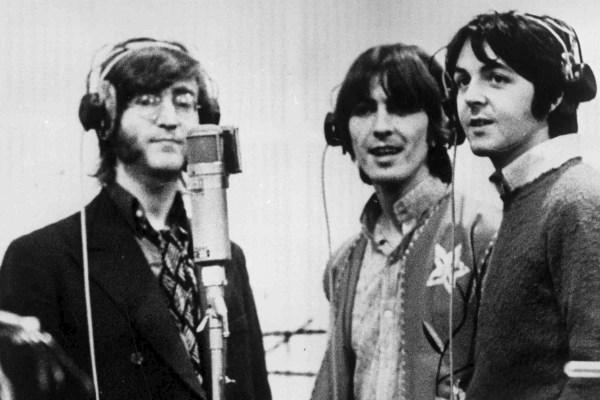 Three Beatles With Headphones Getty