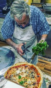 Domenico-DeMarco-cutting-basil-at-DiFara-Midwood-Brooklyn-full-size-1769x3024