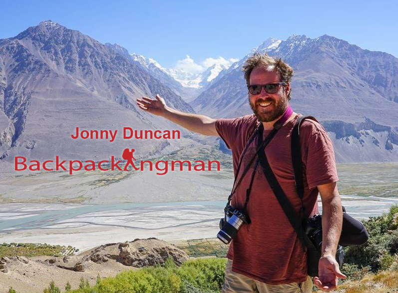 Jonny duncan at the Wakhan Valley with the Hindu Kush Mountains of Afghanistan in the background.