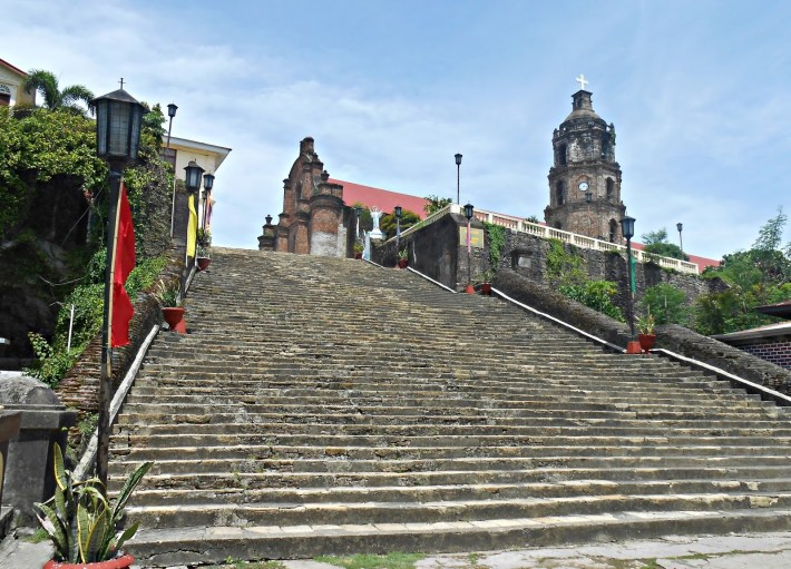The church is reached by climbing an 85-step stairway of granite rock.