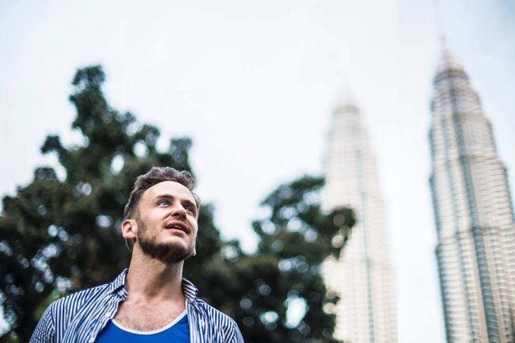 Robert Schrader at KLCC Park, Kuala Lumpur, Malaysia. Photo on the background is the Petronas Tower