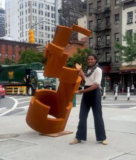 Artist Jordan Baker-Caldwell with his sculpture Ascension