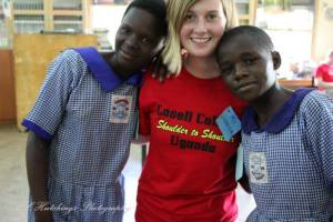 jess with the kids in uganda classroom