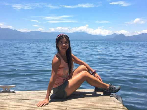 YanYan Yan poses in front of a body of water in Guatemala