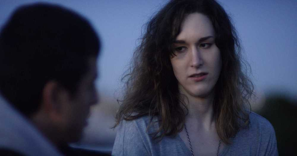 """Transgender Immigrant film """"Lupe Woman looking at blurred man."""