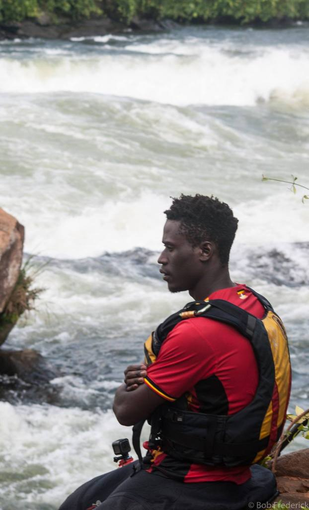 Kokatat Global Brand Ambassador--Professional Whitewater Kayaker Sadat Kawawa sitting by the river at Itanda Falls, Uganda