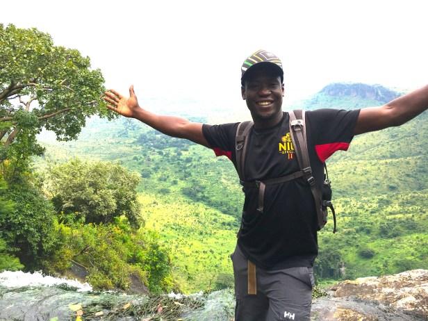 Professional Whitewater Kayaker--Sadat Kawawa Hiking Mout Jinja, Uganda. Credit: Sadat Kawawa
