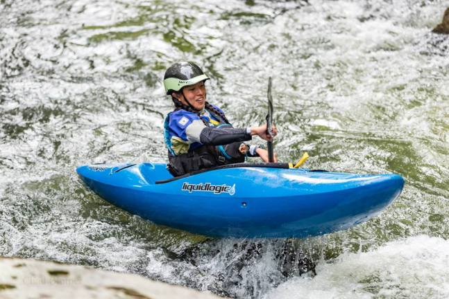 Diversify Whitewater co-founder — Lily Durkee kayaking the Upper Green River in North Carolina, U.S.A. Credit: Chad Blotner