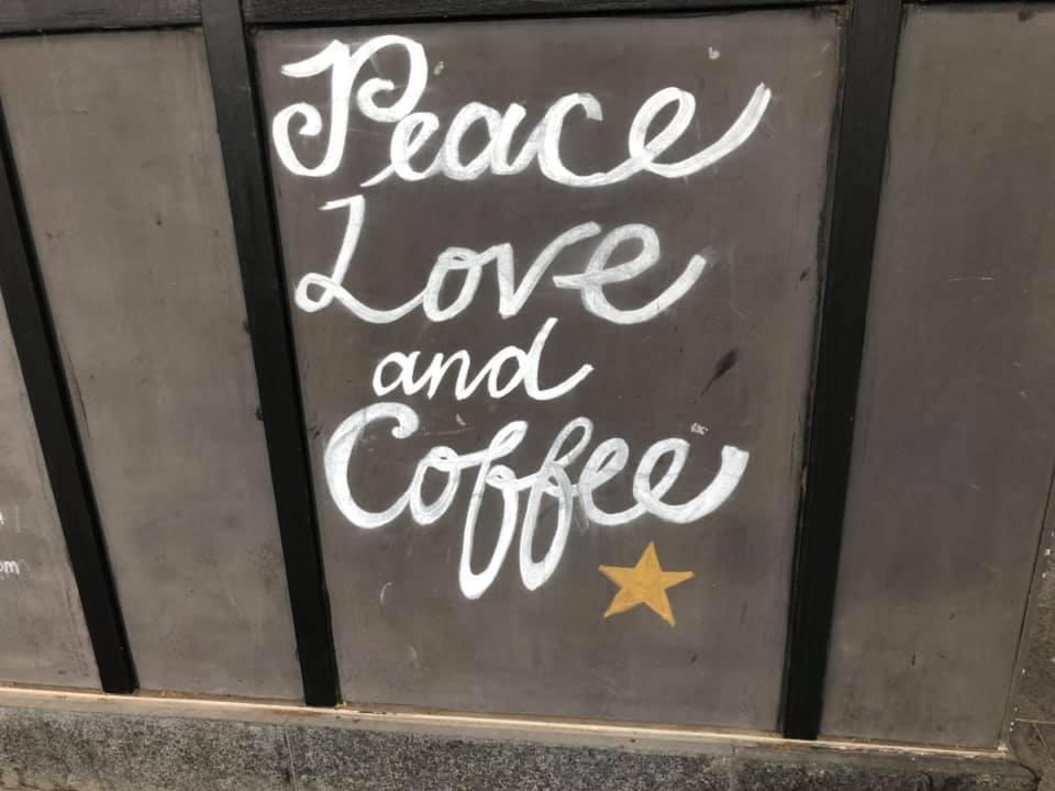 """""""Peace Love and Coffee"""" Ehrets favorite coffee shop down the street from her apartment in Australia."""