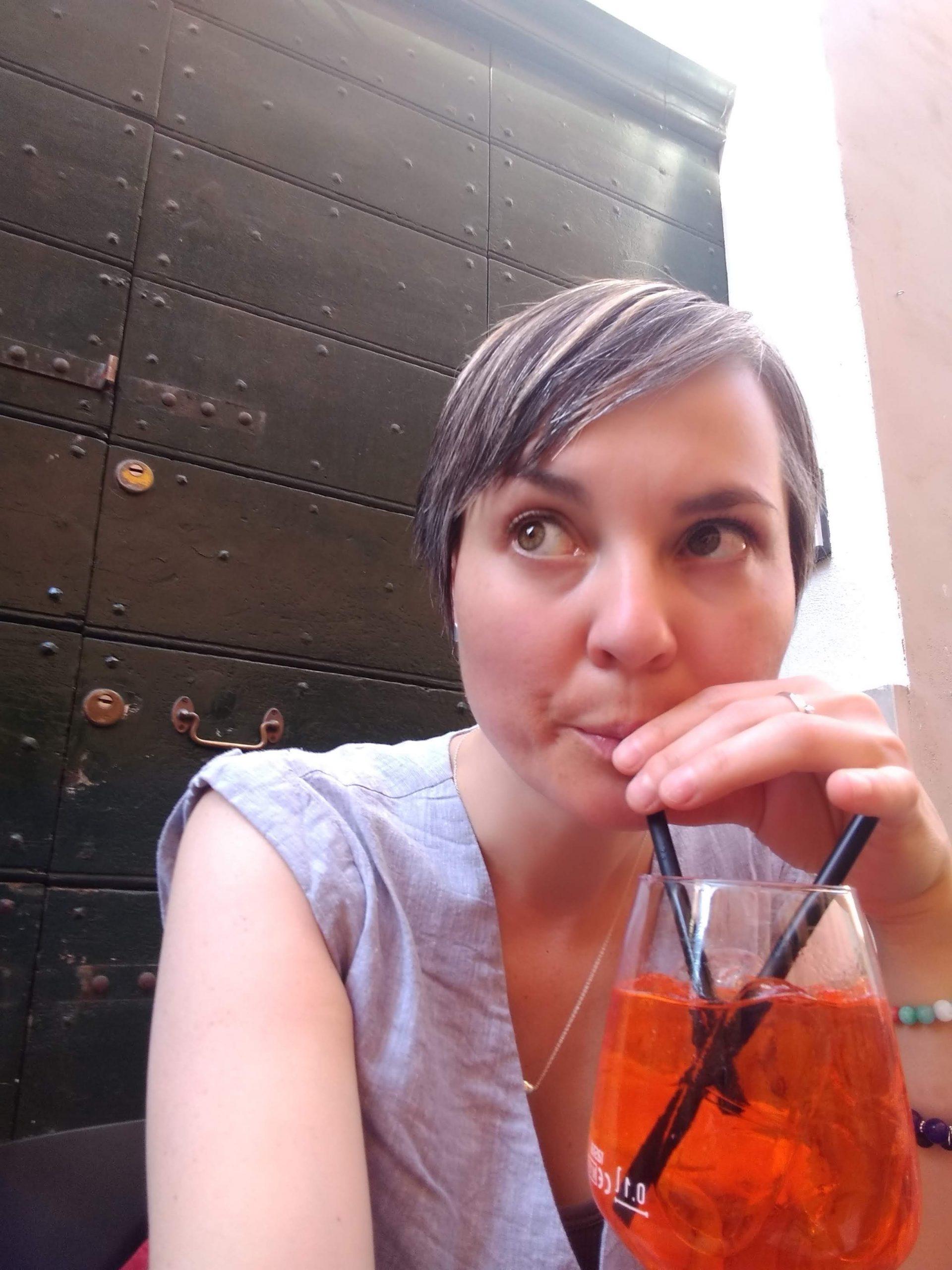 Woman drinking an Aperol Spritz