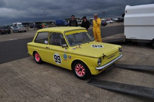 Matching tie & hanky? No - just a race suit colour coordinated with this 1965 Hillman Imp Rallye. Not sure about the pink wheels though!