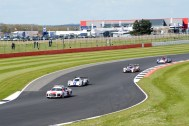 LMP2 and LMP3 cars behind the safety car at Becketts