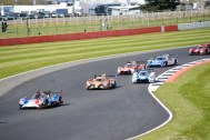 LMP2 and LMP3 cars fighting it out on track