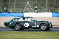 '58 XK150 Jaguar passing '59 Lotus Elite