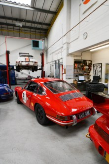 Steve's red race car and Simon's white striped race car resplendent in Spa grime