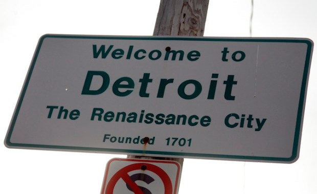 A 'Welcome to Detroit' sign is seen along 8 Mile Road in Detroit