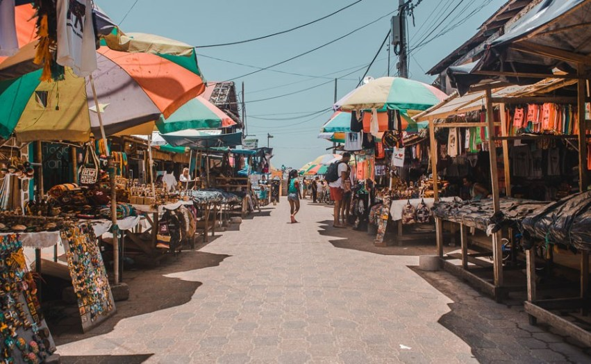 Rows of street stalls with souvenirs in Montañita Ecuador