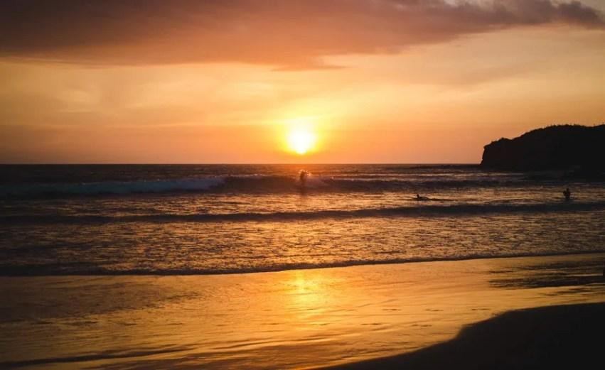 surfing at sunset Montañita ecuador
