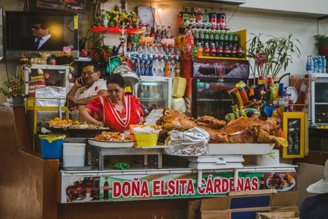 food stall in Latin America Ecuador Cuenca serving pork belly