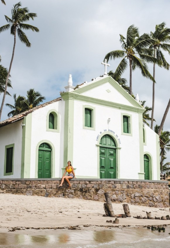 travel blogger girl on chapel on beach of praia dos carneirhos - 2 weeks north brazil itinerary