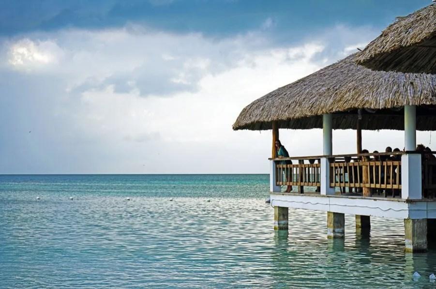 best central american beaches: koko king caye caulker belize jetty into sea
