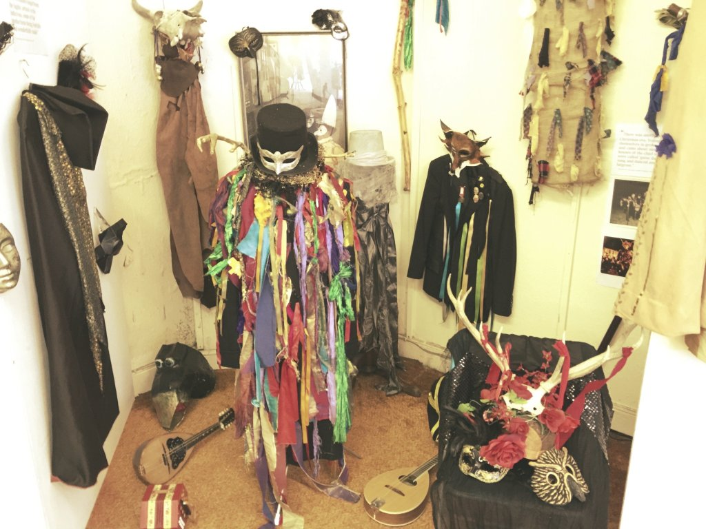 Photograph of folk objects such as animal masks, instruments, tatters jackets.