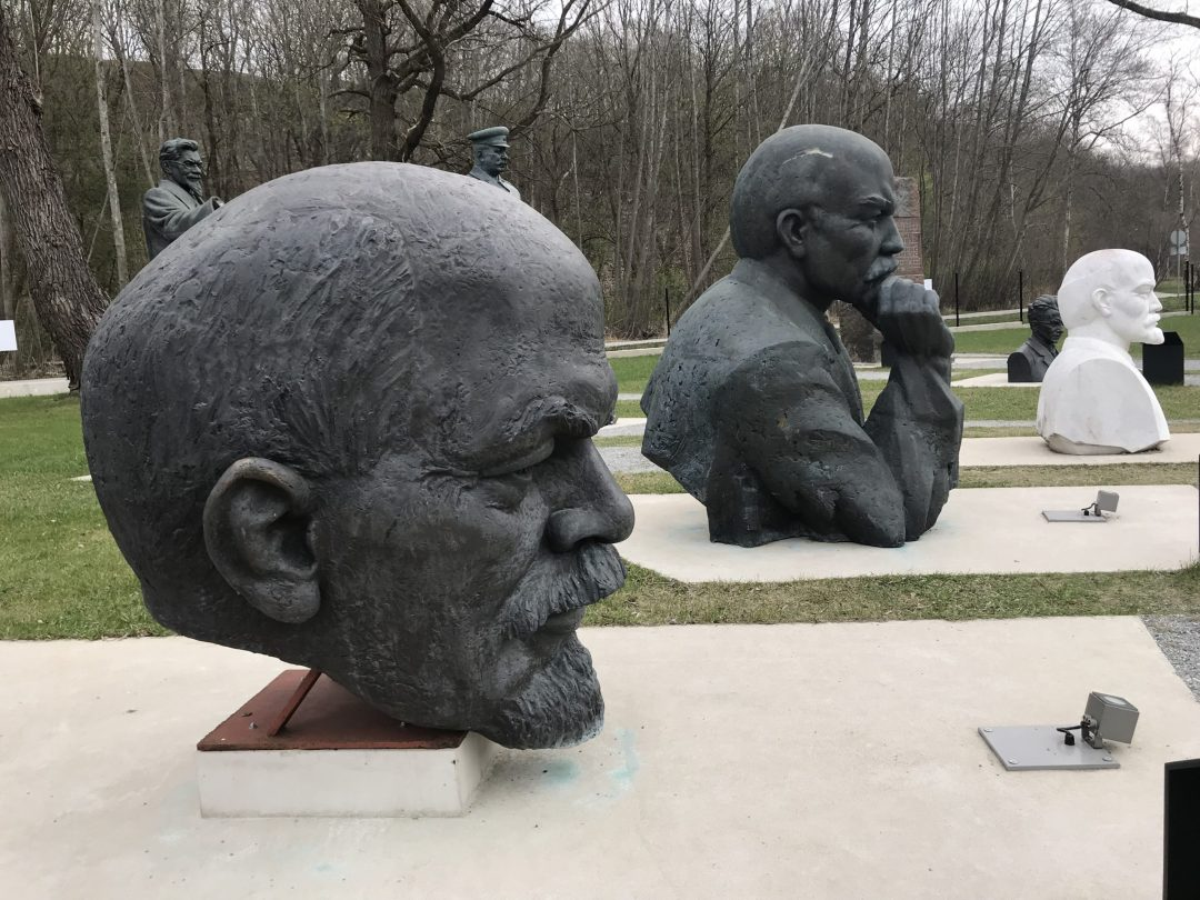 Decapitated heads of bronze statues of Lenin, Stalin and other Soviet leaders in an outdoor exhibition of political statues removed from the public realm, Estonian History Museum, Tallinn