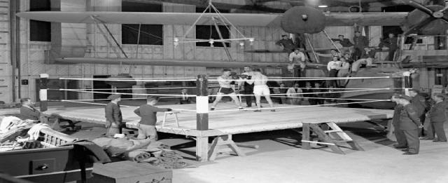 Boxing match in No.1 Hangar, Royal Canadian Air Force Station Coal Harbour, British Columbia, Canada, 15 May 1942