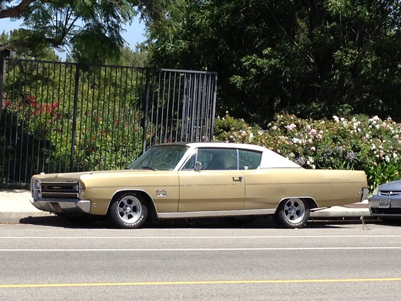 Curbside Compadres: 1968 Plymouth Sport Fury and Friend