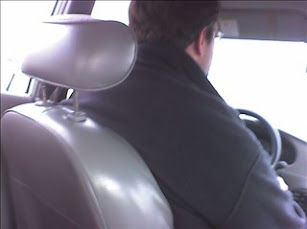 Big man in a llliiiitttlllee car...
