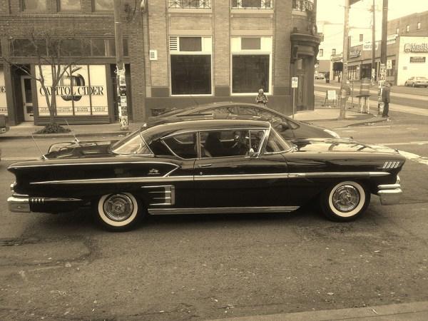 Chevrolet-1958-impala-and-Prius-1-bw